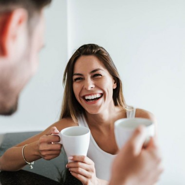 AdobeStock_208131995@bnenin_Laughing couple drinking coffee in the morning